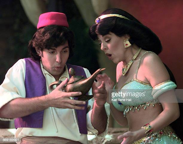 CAPrincesslamp1KRH6/25/97Aladdin rubs the magic lamp as Jasmine watches on in the Princess Story Telling attraction at Aladdin's Oasis in...