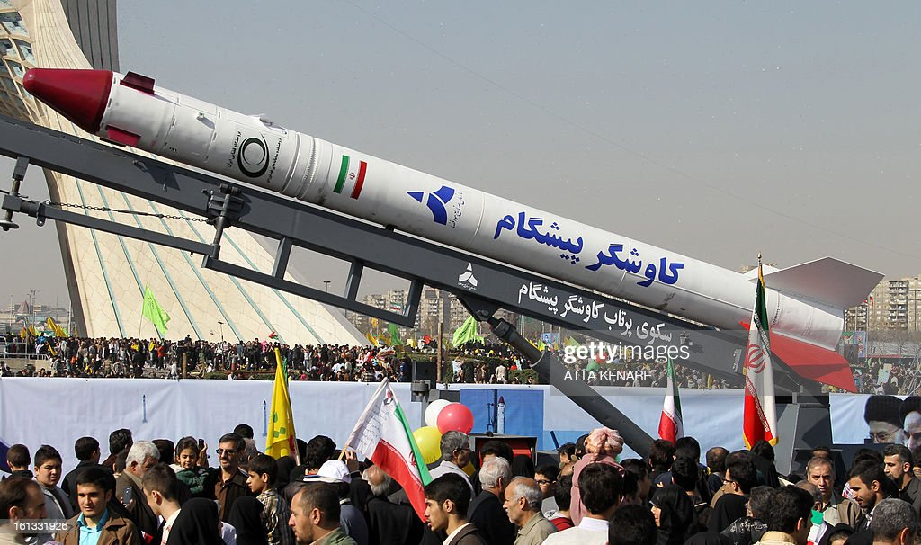 A capsule, codenamed Pishgam (Pioneer), that was sent into space containing a live monkey in January is displayed during a rally in Tehran's Azadi Square (Freedom Square) to mark the 34th anniversary of the Islamic revolution on February 10, 2013. Hundreds of thousands of people marched in Tehran and other cities chanting 'Death to America' and 'Death to Israel' as Iran celebrated the anniversary of the ousting of the US-backed shah. AFP PHOTO / ATTA KENARE