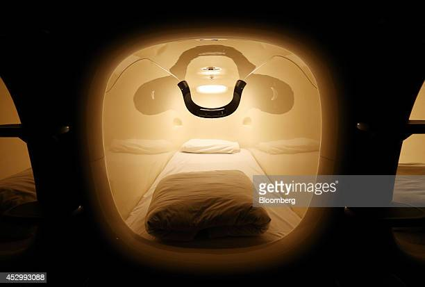 A capsule unit stands in the Nine Hours Narita Airport capsule hotel operated by nine hours Inc at Narita Airport in Narita Japan on Thursday July 31...
