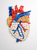 Capsules and pills in shape of human heart