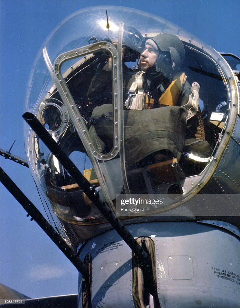 Capt. Charles S. Hudson, the most decorated bombardier of the US Army Air Corps' 8th Air Force, in the nose of a B-17 bomber at a base in England, mid-1940s.