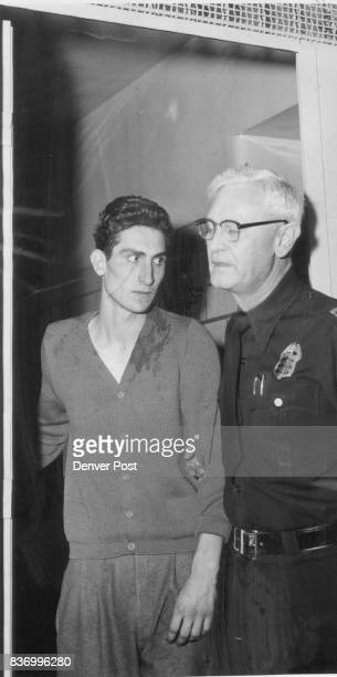 Capt Harry Johnson escorts Frank Archina through a door at city jail where Archina awaits trial on charges of murdering Mrs Elizabeth Macri 60...