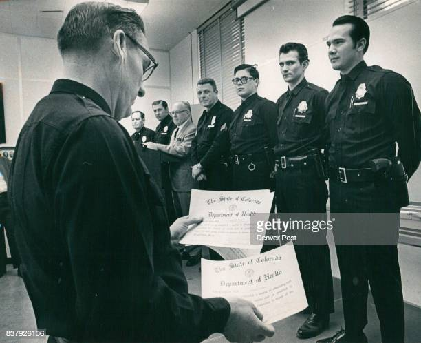 Capt James Powers Left Foreground Presents Certificates To The Officers Among those at ceremony were Lt Wallace Horan of the Traffic Division and...