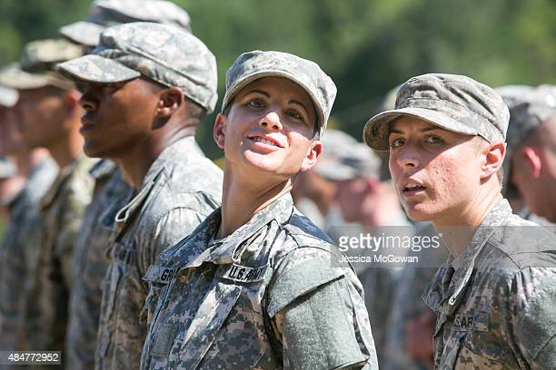 Capt Kristen Griest and 1st Lt Shaye Haver look on during the graduation ceremony of the United States Army's Ranger School on August 21 2015 at Fort...