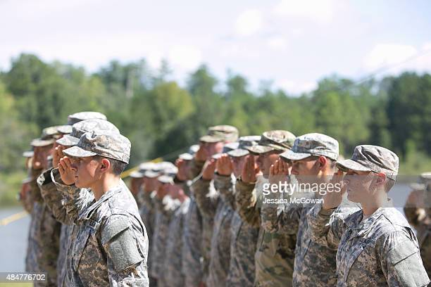 Capt Kristen Griest and 1st Lt Shaye Haver salute during the graduation ceremony of the United States Army's Ranger School at Fort Benning Georgia on...