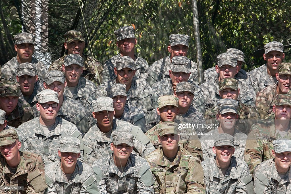 Capt. Kristen Griest (center left) and 1st Lt. Shaye Haver (center right) sit amongst their male Ranger classmates watching live demonstrations during the graduation ceremony of the United States Army's Ranger School at Fort Benning, Georgia on August 21, 2015. Capt. Griest and 1st Lt. Shaye Haver are the first women ever to successfully complete the U.S. Army's Ranger School.