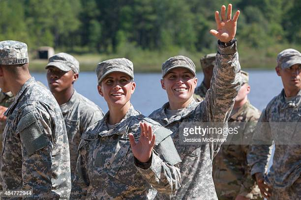 Capt Kristen Griest and 1st Lt Shaye Haver wave to friends and family gathered during the graduation ceremony of the United States Army's Ranger...