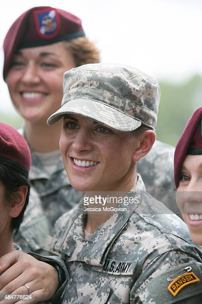 Capt Kristen Griest stands amongst female soldiers after receiving her Ranger tab at the graduation ceremony of the United States Army's Ranger...