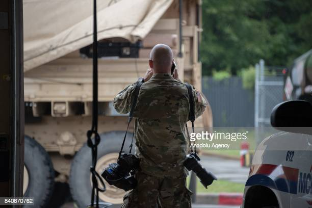 Capt Loyal Auterson on the phone while he awaits the USA Army rescue helicopter at MCHD EMS Station 30 heliport during hurricane Harvey in Humble TX...