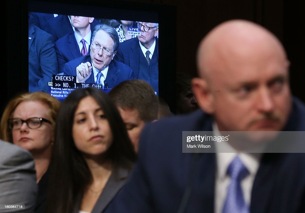 Capt. Mark Kelly, USN (Ret.) listens to Wayne LaPierre Executive Vice President and CEO of the National Rifle Association testify during a Senate Judiciary Committee hearing on gun violence, January 30, 2013 in Washington, DC. The committee is hearing testimony on what can be done to curb gun violence in America.