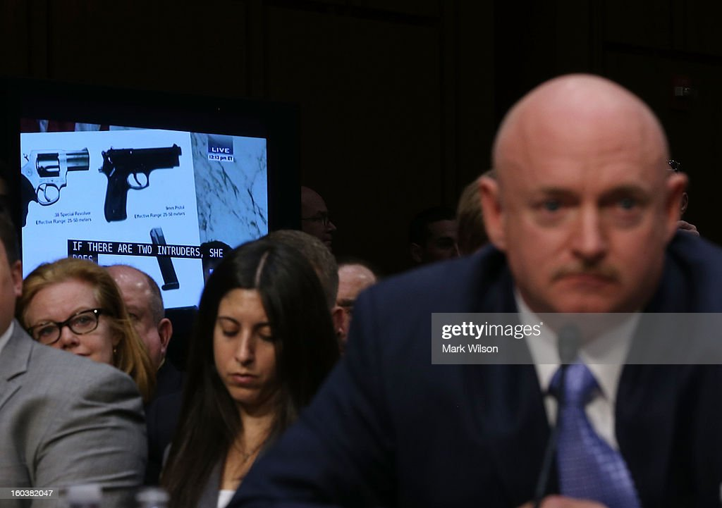 Capt. Mark Kelly, USN Ret. listens to testimony during a Senate Judiciary Committee hearing on gun violence, January 30, 2013 in Washington, DC. The committee is hearing testimony on what can be done to curb gun violence in America.