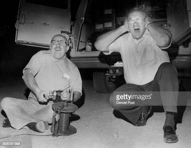 Capt Robert Shaughnessy right sets off 2½ pounds of C4 explosives as Detective Robert V Weyand' holds his ears to soften the noise The explosion...