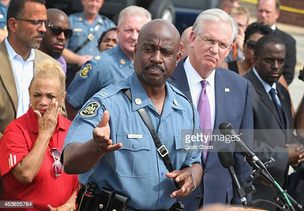 Capt Ronald Johnson of the Missouri State Highway Patrol and Governor Jay Nixon of Missouri speak to the media on August 15 2014 in St Louis Missouri...