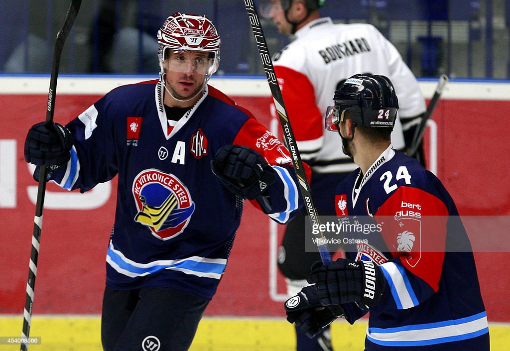Captain #A Peter Huzevka (2R) of Vitkovice Ostrava celebrates with teammate #24 Ondrej Sedivy after scoring a goal during the Champions Hockey League group stage game between Vitkovice Ostrave and EV Zug on August 23, 2014 in Ostrava, Czech Republic.