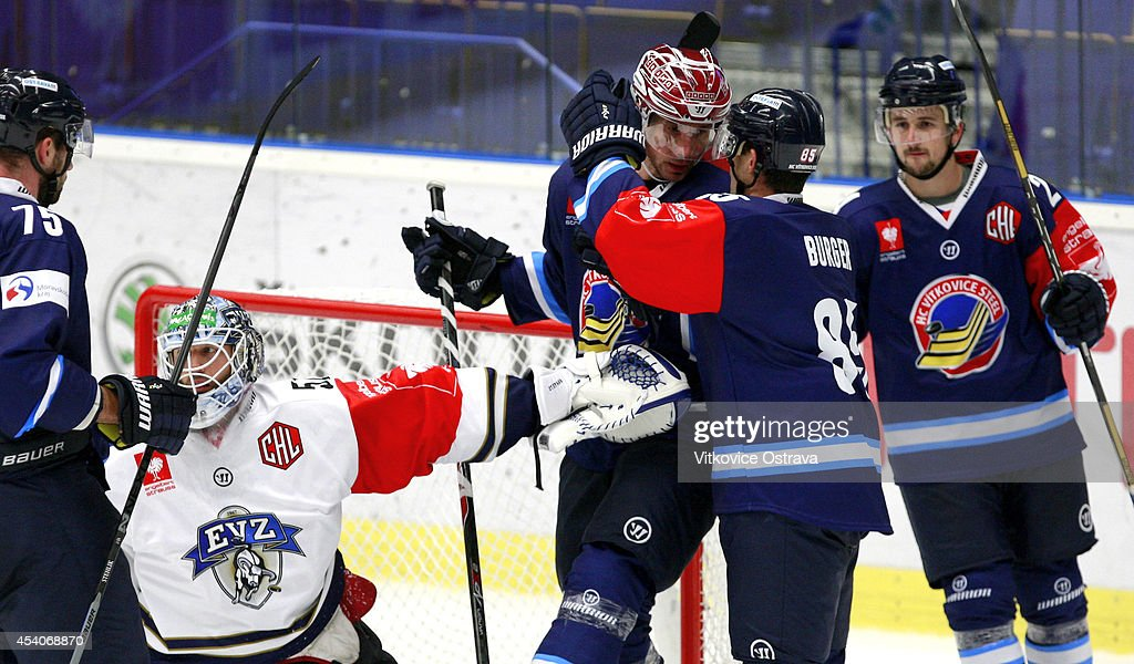 Captain #A Peter Huzevka (3R) of Vitkovice Ostrava is congratulated by teammates after scoring a goal during the Champions Hockey League group stage game between Vitkovice Ostrave and EV Zug on August 23, 2014 in Ostrava, Czech Republic.
