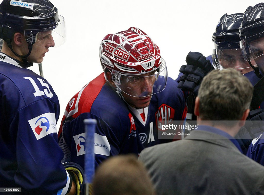 Captain #A Peter Huzevka (2R) of Vitkovice Ostrava listens to a team-talk during the Champions Hockey League group stage game between Vitkovice Ostrave and EV Zug on August 23, 2014 in Ostrava, Czech Republic.