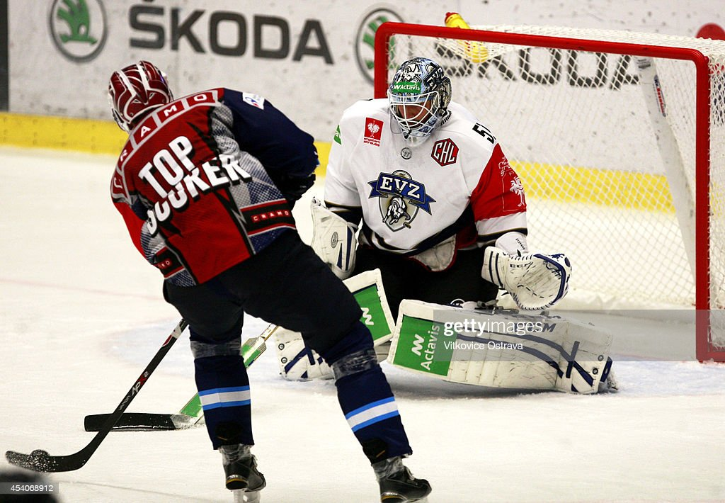 Captain #A Peter Huzevka (2R) of Vitkovice Ostrava scores a goal during the Champions Hockey League group stage game between Vitkovice Ostrave and EV Zug on August 23, 2014 in Ostrava, Czech Republic.