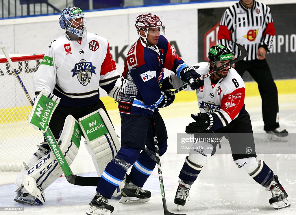 Captain #A Peter Huzevka (2R) of Vitkovice Ostrava tabgles with #6 Tim Ramholt of EV Zug during the Champions Hockey League group stage game between Vitkovice Ostrave and EV Zug on August 23, 2014 in Ostrava, Czech Republic.