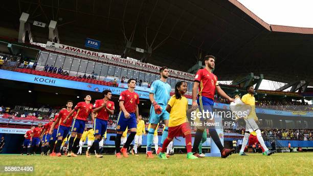 Captain Abel Ruiz of Spain leads his side out for the FIFA U17 World Cup India 2017 group D match between Brazil and Spain at the Jawaharlal Nehru...
