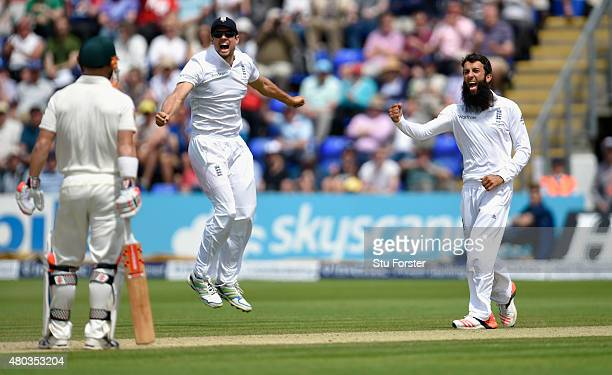Captain Alastair Cook and bowler Moeen Ali celebrate after dismissing Australia batsman David Warner during day four of the 1st Investec Ashes Test...
