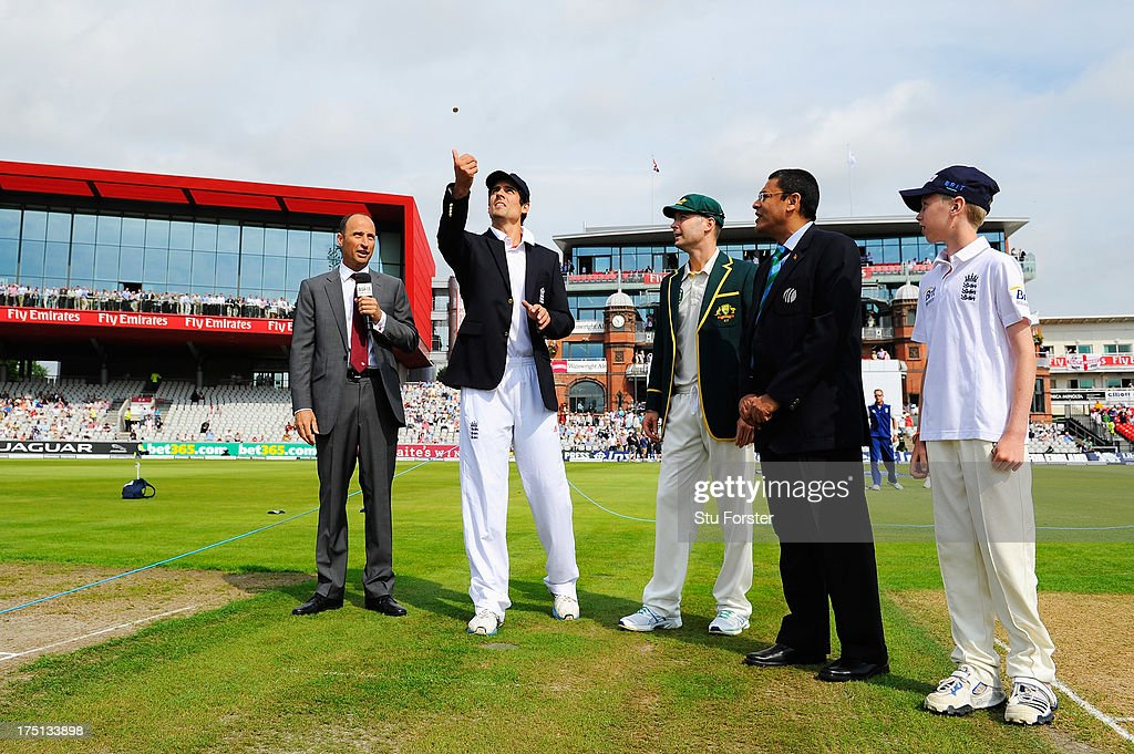Captain Alastair Cook of England tosses the coin watched by Australian captain Michael Clarke, commentator Nasser Hussain (L) and match referee Ranjan Madugalle during day one of the 3rd Investec Ashes Test match between England and Australia at Old Trafford Cricket Ground on August 1, 2013 in Manchester, England.