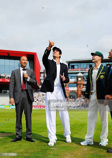 Captain Alastair Cook of England tosses the coin watched by Australian captain Michael Clarke and commentator Nasser Hussain during day one of the...