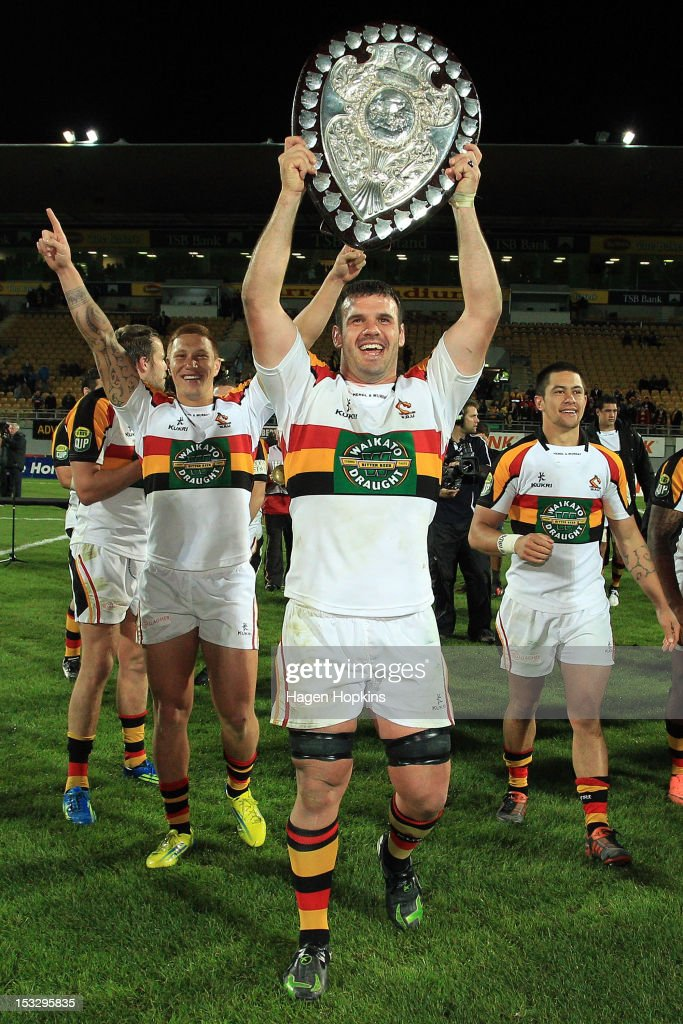 Captain Alex Bradley of Waikato celebrates after winning the Ranfurly Shield during the round twelve ITM Cup match between Taranaki and Waikato at...