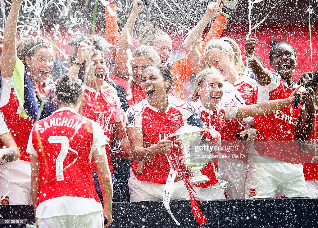 Captain Alex Scott of Arsenal celebrates their victory with her team mates and the FA Cup during the SSE Women's FA Cup Final between Arsenal Ladies...