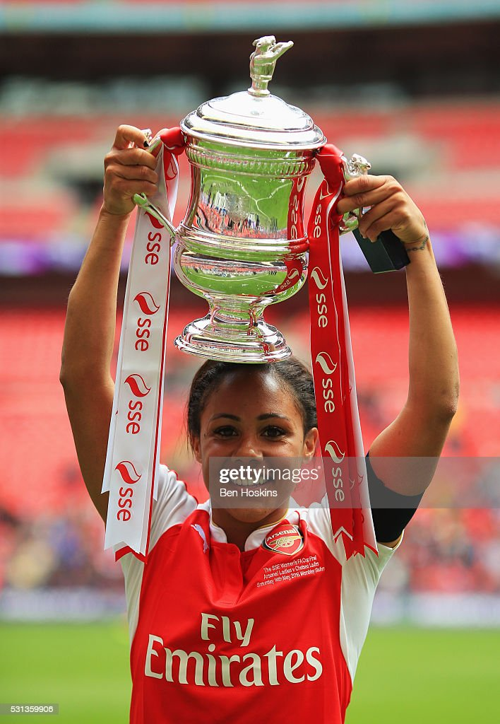 Captain Alex Scott of Arsenal celebrates with the trophy after the SSE Women's FA Cup Final between Arsenal Ladies and Chelsea Ladies at Wembley...