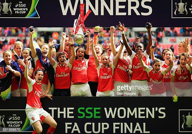 Captain Alex Scott of Arsenal lifts the trophy as they celebrate victory after the SSE Women's FA Cup Final between Arsenal Ladies and Chelsea Ladies...