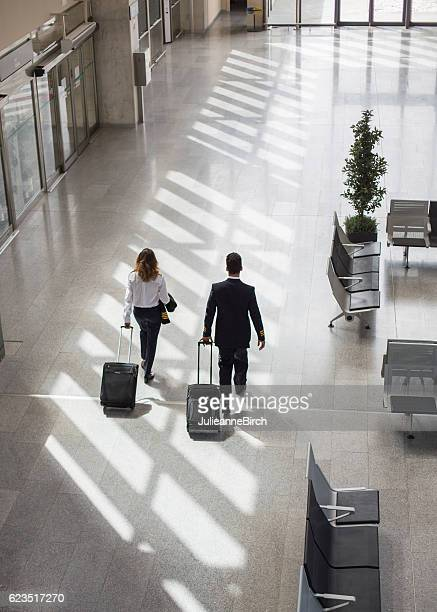 Captain and Pilot walking through airport terminal