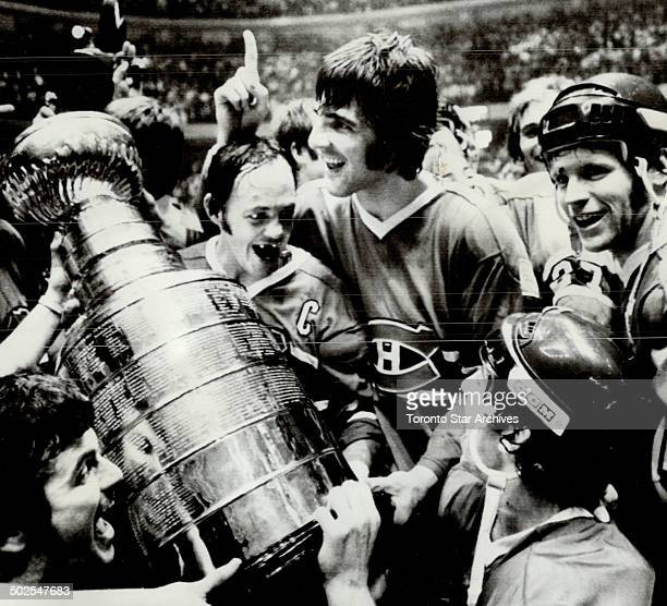 Captain and the cup Montreal Canadiens' captain Yvan Court accepted Stanley Cup last night climaxing first season as cap He succeeded Henri Richard...