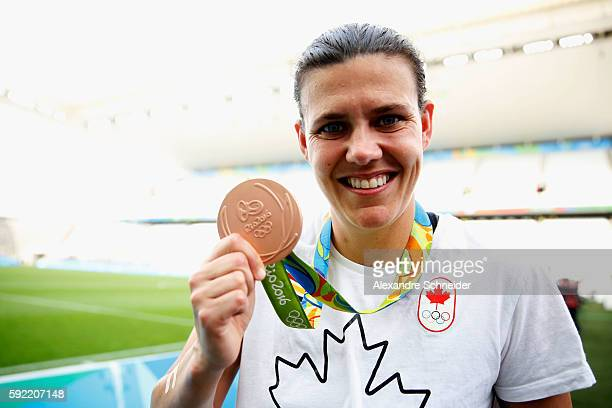 Captain and winning goalscorer Christine Sinclair of Canada celebrates with her medal following her teams victory during the Women's Olympic Football...