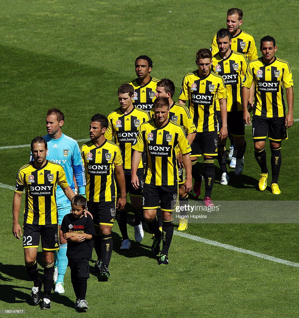 Captain Andrew Durante of the Phoenix leads his team onto the field during the round 18 A-League match between the Wellington Phoenix and the Newcastle Jets at Westpac Stadium on January 27, 2013 in Wellington, New Zealand.