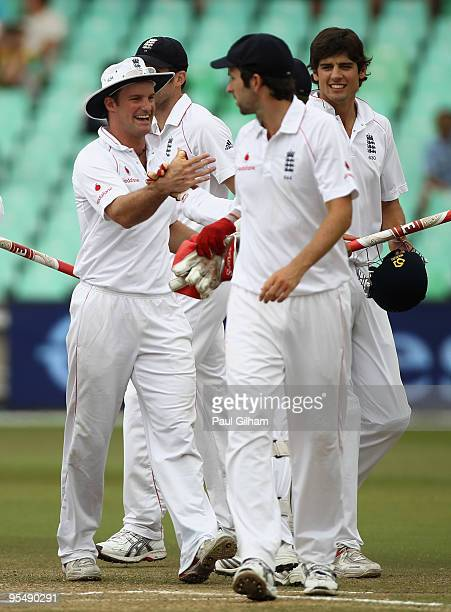 Captain Andrew Strauss of England celebrates with his teammates following England's victory over South Africa by an innings and 98 runs during day...