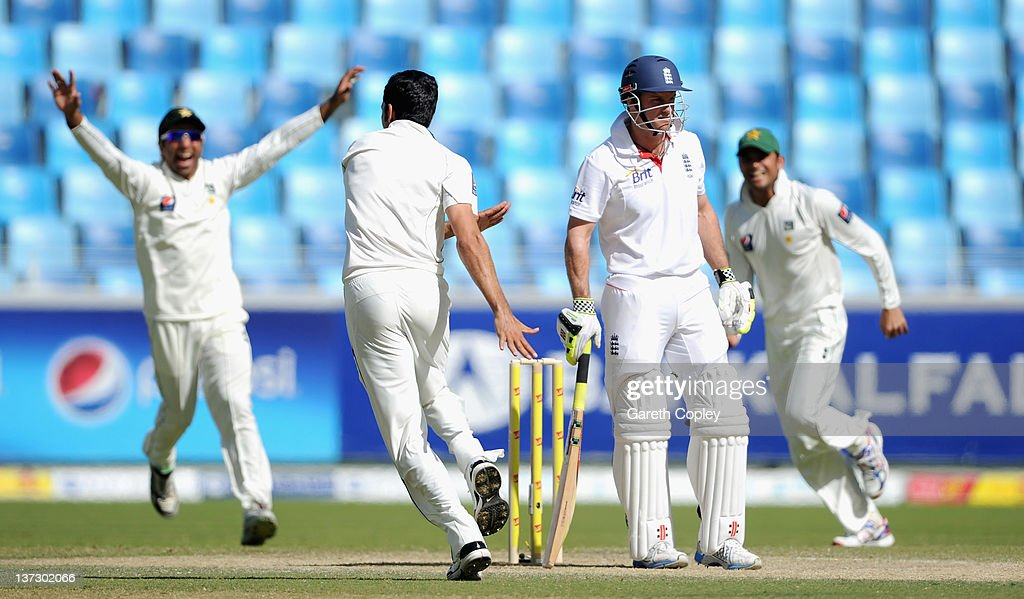 Captain <a gi-track='captionPersonalityLinkClicked' href=/galleries/search?phrase=Andrew+Strauss&family=editorial&specificpeople=157548 ng-click='$event.stopPropagation()'>Andrew Strauss</a>(2nd R) of England reacts after being dismissed by Umar Gul of Pakistan during the first Test match between Pakistan and England at The Dubai International Cricket Stadium on January 19, 2012 in Dubai, United Arab Emirates.