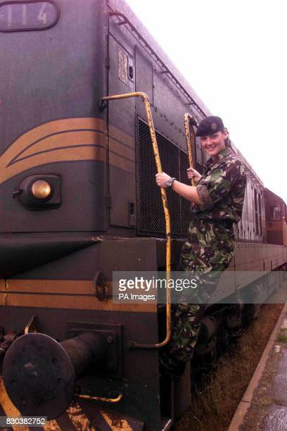 Captain Anna Stephens officer commanding Railtroop of 79 Squadron with one of the diesel locomotives to be used by NATO on the rail line between...