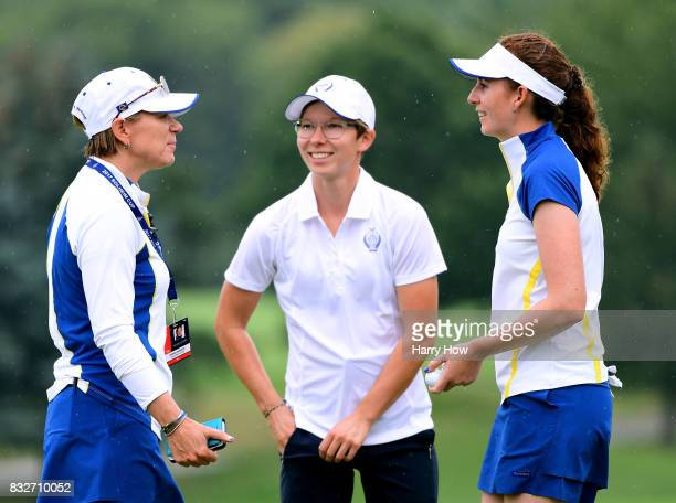 Captain Annika Sorenstam of Europe speaks with Florentyna Parker and AnnKathrin Lindner on the 18th green during practice for the Solheim Cup at the...
