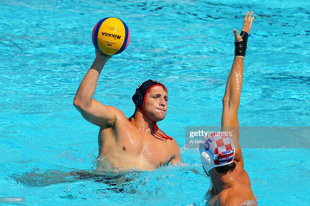 Captain Anthony Azevedo of USA looks to pass the ball under pressure from Maro Jokovic of Croatia during the Men's Water Polo first preliminary round match between USA and Croatia during day three of the 15th FINA World Championships at Piscines Bernat Picornell on July 22, 2013 in Barcelona, Spain.