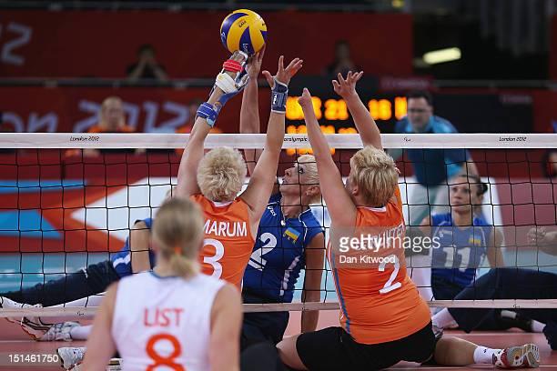 Captain Anzhelika Churkina of the Ukrain reaches for the ball during the Bronze Medal Women's Sitting Volleyball Match against The Netherlands on day...