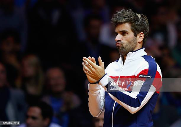 Captain Arnaud Clement of France supports JoWilfried Tsonga of France in his match against Stanislas Wawrinka of Switzerland during day one of the...