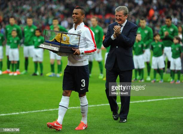 Captain Ashley Cole of England is honoured with his 100th cap as Roy Hodgson manager of England looks on prior to the International Friendly match...