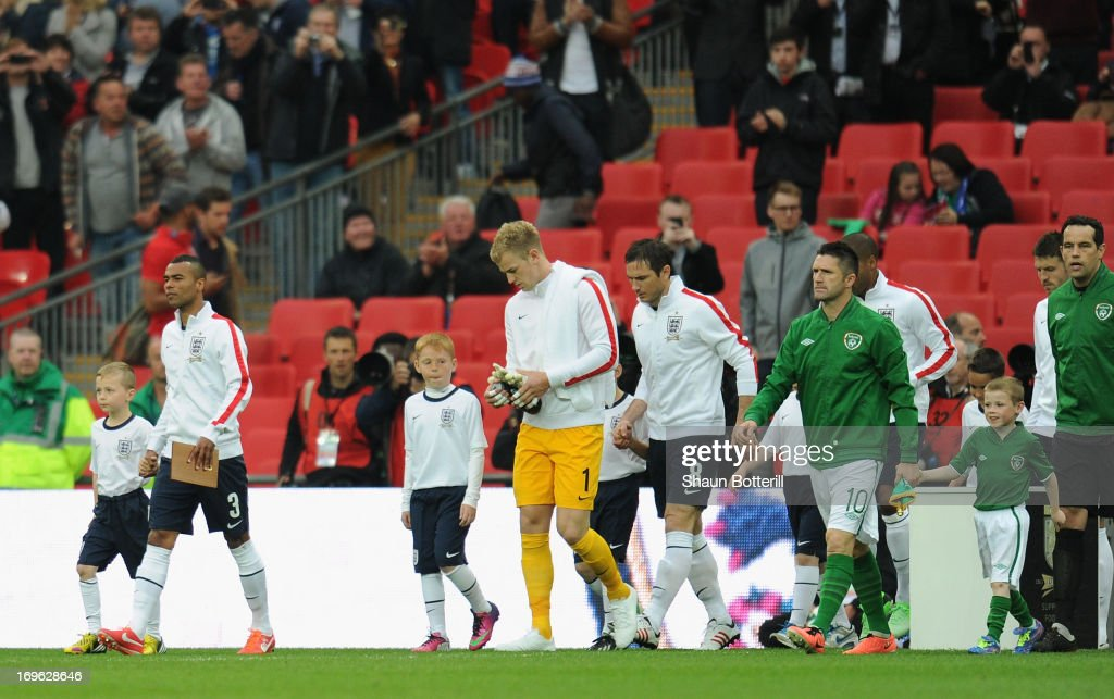 Captain Ashley Cole of England leads out the team in honour of his 100th cap prior to the International Friendly match between England and the...