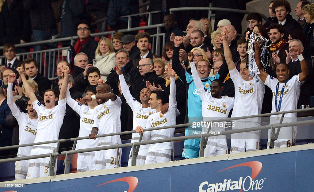 Captain Ashley Williams (R) of Swansea City and Garry Monk of Swansea City lift the Capital One Cup during the Capital One Cup Final match between Bradford City and Swansea City at Wembley Stadium on February 24, 2013 in London, England.