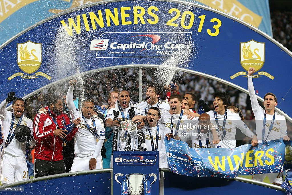 Captain Ashley Williams of Swansea City and team mates celebrate with the trophy during the Capital One Cup Final match between Bradford City and Swansea City at Wembley Stadium on February 24, 2013 in London, England.