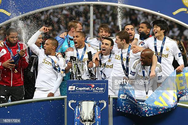 Captain Ashley Williams of Swansea City and team mates celebrate with the trophy during the Capital One Cup Final match between Bradford City and...