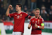 Captain Balazs Dzsudzsak and Richard Guzmics of Hungary celebrate their team's 21 victory and qualification following the UEFA EURO 2016 Qualifier...