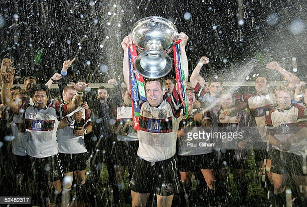 Captain Barry Williams of NeathSwansea Ospreys lifts the Celtic League Trophy after winning the league during the Celtic League match between...
