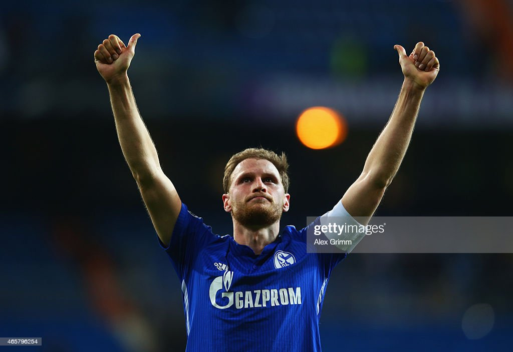 Captain <a gi-track='captionPersonalityLinkClicked' href=/galleries/search?phrase=Benedikt+Hoewedes&family=editorial&specificpeople=3945465 ng-click='$event.stopPropagation()'>Benedikt Hoewedes</a> of Schalke salutes the fans after the UEFA Champions League Round of 16 second leg match between Real Madrid CF and FC Schalke 04 at Estadio Bernabeu on March 10, 2015 in Madrid, Spain. Schalke won the match 4-3, but lost 5-4 on aggregate.
