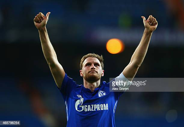 Captain Benedikt Hoewedes of Schalke salutes the fans after the UEFA Champions League Round of 16 second leg match between Real Madrid CF and FC...